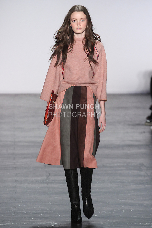 """Model Megan walks runway in a wool raglan sweater with embroidered trim in rose quartz, and ultra suede gored skirt, from the Vivienne Tam Fall Winter 2016 """"Cultural Dreamland The New Silk Road"""" collection, presented at NYFW: The Shows Fall 2016, during New York Fashion Week Fall 2016."""