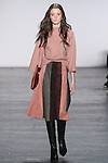 "Model Megan walks runway in a wool raglan sweater with embroidered trim in rose quartz, and ultra suede gored skirt, from the Vivienne Tam Fall Winter 2016 ""Cultural Dreamland The New Silk Road"" collection, presented at NYFW: The Shows Fall 2016, during New York Fashion Week Fall 2016."