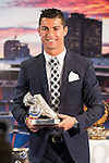 Cristiano Ronaldo poses with the award for top scorer during the tribute to Cristiano Ronaldo by Real Madrid CF on the occasion of his new record by being the top scorer in the club's history at Santiago Bernabeu Stadium in Madrid, October 02, 2015.<br /> (ALTERPHOTOS/BorjaB.Hojas)