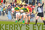 Ref-it's not a fair cop! Cork's James Fitzpatrick is about to feel the referee's displeasure as he puts a headlock on Kerry midfielder David Moran in their Cadbury's U21 Munster Football semi-final in Tralee on Saturday.   Copyright Kerry's Eye 2008