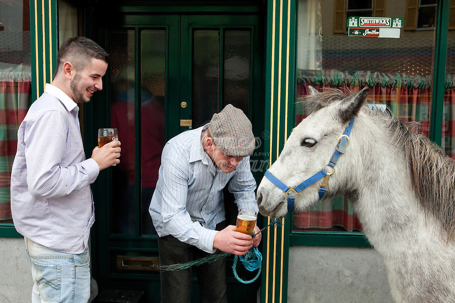 4/10/2010. Travelers have a pint with their pony outside of Ryans bar at the Ballinasloe Horse Fair, Ballinasloe, Ireland. Picture James Horan