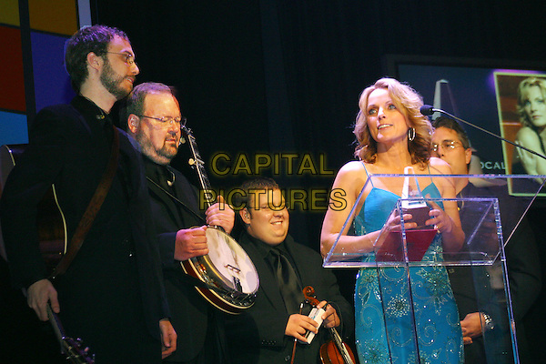 October 27, 2005 - International Bluegrass Music Association (IBMA) Awards - Ryman Auditorium, Nashville, Tennessee - Rhonda Vincent wins Female Vocalist Of the Year for an unprecedented 6th year in a row while her band The Rage watch..Photo Credit: Randi Radcliff/AdMedia