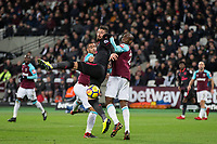 Olivier Giroud of Arsenal sandwiched between Winston Reid (left) & Angelo Ogbonna of West Ham United during the Premier League match between West Ham United and Arsenal at the Olympic Park, London, England on 13 December 2017. Photo by Andy Rowland.