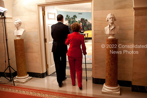 Washington, DC - June 2, 2009 -- United States President Barack Obama escorts former First Lady Nancy Reagan into the Diplomatic Room of the White House June 2, 2009, for the announcement and signing of the Ronald Reagan Centennial Commission Act--commemorating the late President's 100th Birthday in 2011.<br /> Mandatory Credit: Pete Souza - White House via CNP