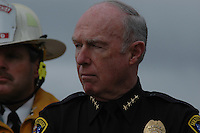 Monday December 8, 2008:  University City, San Diego California.  Police Chief William Landsdowne listens as Mayor Jerry Sanders addresss the media at the scence where a military jet crashed into a residential home killing at least 2 civilians.  At approximately 11:59am a USMC F-18 fighter jet encountered trouble over this residential area of the city and the pilot ejected leaving his aircraft to crash into a residential neighborhood.