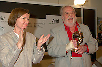 """Aug 25th File Photo of recently deceased <br /> Spanish actor FRANCISCO RABAL (R)  pose for a photo as he receive  a Special Grand Prize of the Americas from  the World Film Festival'sViice President DaniËle Cauchard,(L) August 25th, 20001 in Montreal , Canada.<br /> , Rabal just died on the plane back home<br /> <br /> <br /> Born in ¡guilas, Spain in 1925, Francisco Rabal . <br /> In 1950 he won his first real stage roles. Luis BuÒuel saw him in Historias de la radio and decided to cast him in the lead role of his new film to be shot in Mexico, NAZARÕN. This marked the beginning not only of Rabal's international career but also his lifelong friendship and collaboration with BuÒuel - including such masterpieces as VIRIDIANA (1961) and BELLE DU JOUR (1967).<br /> As a result of his performances in BuÒuel's early films, Rabal was sought after by many of the era's top international directors - Antonioni (THE ECLIPSE), Rivette (THE NUN), Visconti (THE WITCHES) - as well as directors of the so-called """"new Spanish cinema"""", in particular Carlos Saura, Miguel Picazo, Antonio Bardem and Jorge Grau. He made his American feature debut in 1977 in William Friedkin's SORCERER and won best actor awards at several festivals, including Cannes 1984 for his role in Mario Camus's THE HOLY INNOCENTS (!984) and the Montreal World Film Festival for his performance in Alain Tanner's THE MAN WHO LOST HIS SHADOW (1991).<br /> Rabal remained very active through the 1980s and 1990s, appearing in films by Pedro AlmÛdvar, Saura, Eliseo Subiela and Arturo Ripstein. In 1999 he played the title role in Saura's GOYA IN BORDEAUX shown at the 1999 Montreal Festival, a performance which won international critical acclaim.<br /> Rabal's cinematic heritage continues in the persons of his actress-daughter Teresa Rabal, director-son Benito Rabal and actor-grandson Liberto Rabal.<br /> <br /> Photo by Pierre Roussel / Getty Images News Service (ON SPEC)<br /> <br /> <br /> NOTE : Nikon D-1 JPEG opened with"""