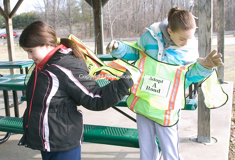 WOODBURY, CT - 07 APRIL 2007 - 040707JW09.jpg -- Nicole Sales age 10 and her friend Allyson Charrette age 10 attempt to put on their safety vests during the town of Woodburys annual spring townwide cleanup Saturday morning. Jonathan Wilcox Republican-American