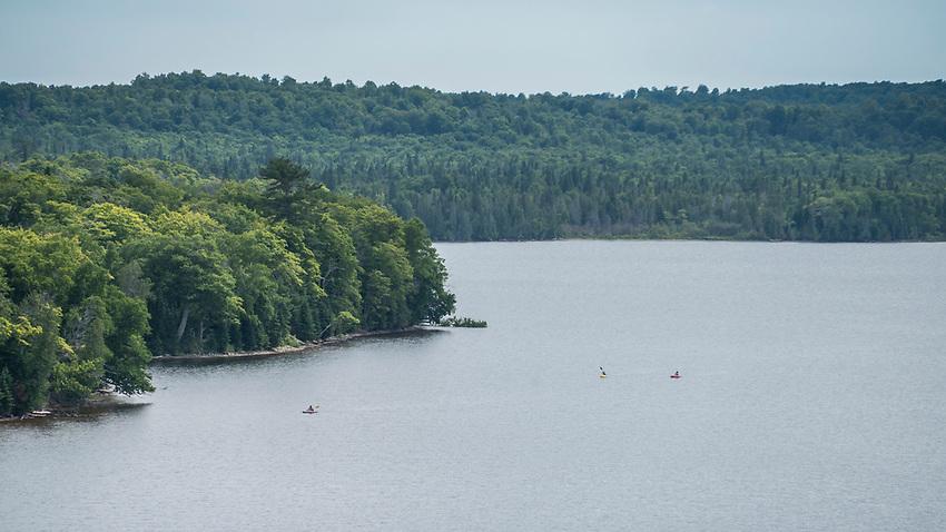 Kayakers on Grand Sable lake of Pictured Rocks National Lakeshore near Grand Marais, Michigan.