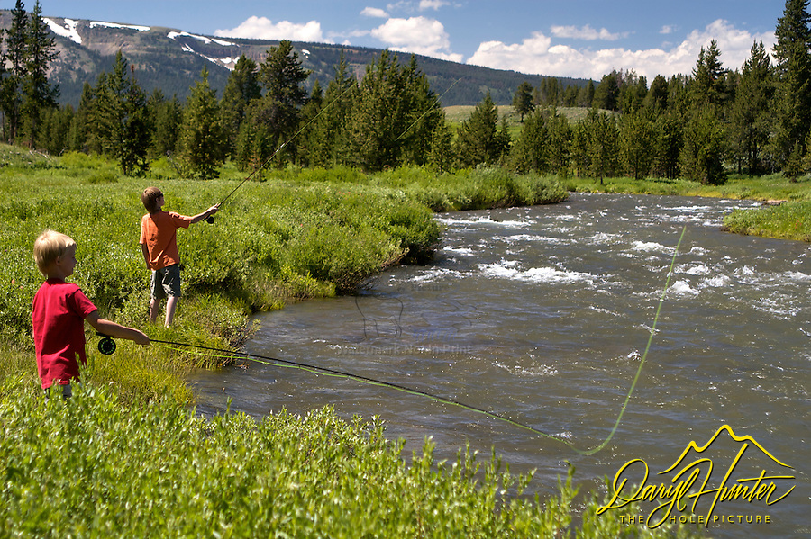 boys fly-fishing the Gardiner River in Yellowstone National Park