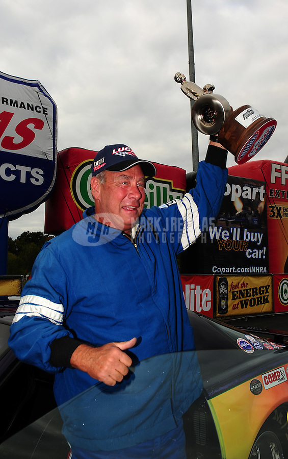 Sept. 18, 2011; Concord, NC, USA: NHRA super stock driver Joe Tysinger celebrates after winning the O'Reilly Auto Parts Nationals at zMax Dragway. Mandatory Credit: Mark J. Rebilas-
