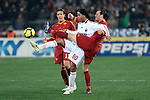 Ronaldinho (Milan) Cassetti e Taddei (Roma).Roma vs Milan.Campionato calcio Serie A.Stadio Olimpico, Roma, 06/03/2010.Photo Antonietta Baldassarre Insidefoto