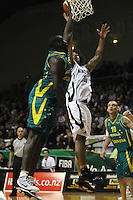 Boomers forward Nathan Jawai tries to block BJ Anthony's layup during the International basketball match between the NZ Tall Blacks and Australian Boomers at TSB Bank Arena, Wellington, New Zealand on 25 August 2009. Photo: Dave Lintott / lintottphoto.co.nz