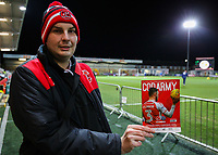 A Fleetwood Town fan holds up a copy of the match day programme before the match<br /> <br /> Photographer Alex Dodd/CameraSport<br /> <br /> The EFL Sky Bet League One - Fleetwood Town v Shrewsbury Town - Tuesday 13th February 2018 - Highbury Stadium - Fleetwood<br /> <br /> World Copyright &copy; 2018 CameraSport. All rights reserved. 43 Linden Ave. Countesthorpe. Leicester. England. LE8 5PG - Tel: +44 (0) 116 277 4147 - admin@camerasport.com - www.camerasport.com