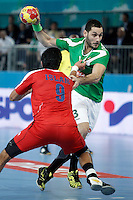 Algeria's Omar Chehbour (r) and Egypt's Islam Hassan during 23rd Men's Handball World Championship preliminary round match.January 15,2013. (ALTERPHOTOS/Acero) /NortePhoto
