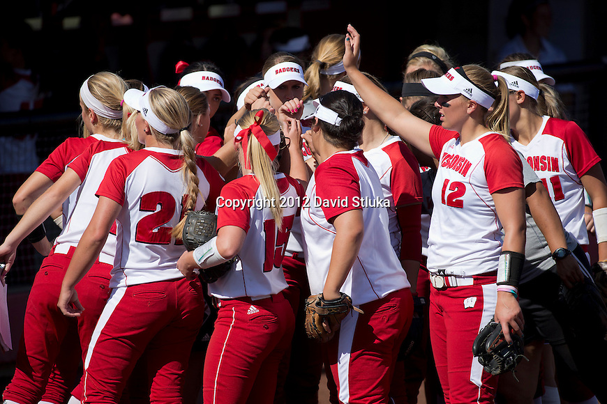 Wisconsin Badgers huddle during an NCAA women's softball game against the Green Bay Phoenix Saturday, September 29, 2012 in Madison, Wis. Wisconsin won 3-1. (Photo by David Stluka)