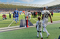 Andre Ayew with child mascot enters the pitch prior to the Sky Bet Championship match between Swansea City and Cardiff City at the Liberty Stadium, Swansea, Wales, UK. Sunday 27 October 2019
