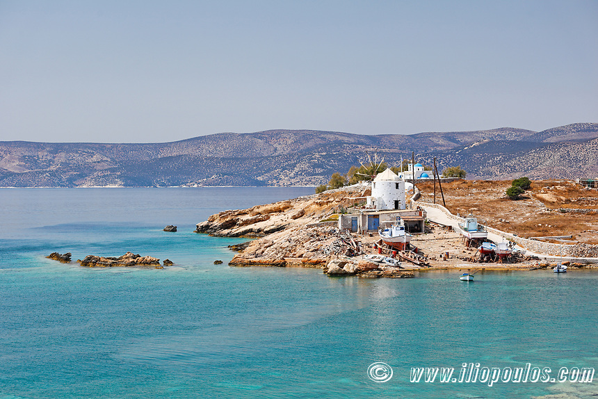 A windmill at Loutro bay of Koufonissi island in Cyclades, Greece