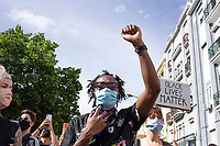 LISBON, PORTUGAL JUNE 06: A protester with a face protective mask its seen during a protest against racism and in favor of respect for life in in Lisbon, on June 6, 2020. <br /> Protesters mourn the death of African-American George Floyd after a Minneapolis police officer knelt on his neck.<br /> (Photo by Luis Boza/VIEWpress)