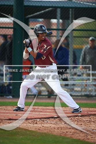 Justin Hue (13) of Calvary Christian Academy High School in Lauderdale Lakes, Florida during the Under Armour All-American Pre-Season Tournament presented by Baseball Factory on January 14, 2017 at Sloan Park in Mesa, Arizona.  (Art Foxall/Mike Janes Photography)