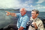 Amateur weather forcaster TP O'Conchuir, left,  checking out the cloud formation at his pub in Ballyferriter, Co. Kerry with local fisherman Brian McCabe.<br /> Picture by Don MacMonagle