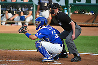 Julian Leon (34) of the Ogden Raptors behind the plate with home plate umpire  Aaron Higgins as the Missoula Osprey played the Ogden Raptors in in Pioneer League action on August 4, 2014 at Lindquist Field in Ogden, Utah. (Stephen Smith/Four Seam Images)