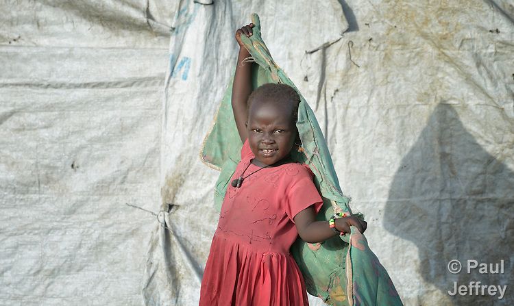 A displaced girl inside a United Nations base in Malakal, South Sudan. More than 20,000 civilians have lived inside the base since shortly after the country's civil war broke out in December, 2013, but renewed fighting in 2015 drove another 5,000 people into the safety of the camp.