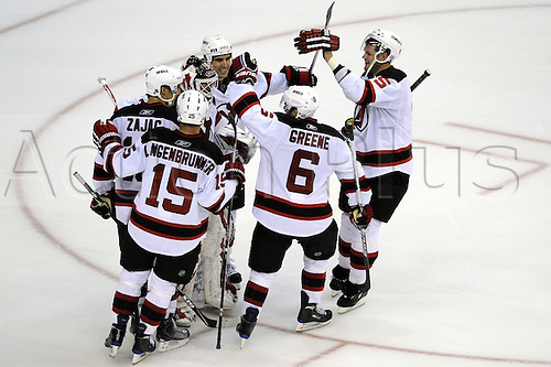 12th October 2009:  New Jersey Devils goalie Martin Brodeur (30) is surrounded by his teammates after the Devils defeated the Washington Capitals 3-2 in a shootout at the Verizon Center in Washington, D.C.   Photo by Mark Goldman/Actionplus. UK Licenses Only..