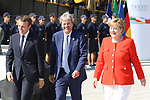 French President Emmanuel Macron, Italian Prime Minister Paolo Gentiloni, German Chancellor Angela Merkel walk at the Trieste Summit - Western Balkans on 12/07/2017 in Trieste, Italy.