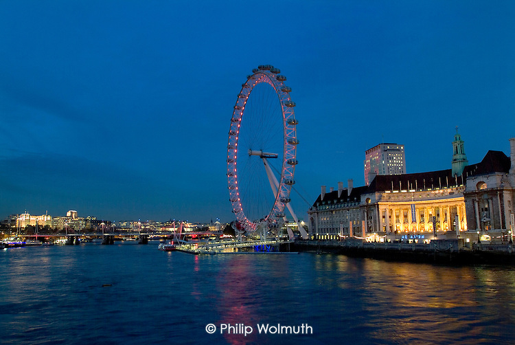 The London Eye and County hHall, now the Saatchi Gallery  , on the South Bank of the River Thames