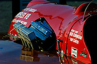 Detail of engine cowling, drivers cowling and windsheild on Buddy Byer's Chrysler Queen.