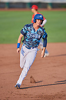 Dillon Paulson (14) of the Ogden Raptors hustles towards third base against the Orem Owlz at Lindquist Field on August 3, 2018 in Ogden, Utah. The Raptors defeated the Owlz 9-4. (Stephen Smith/Four Seam Images)