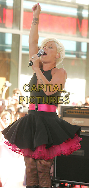 PINK.performs on the 'Today Show held at Today Show Studios, New York, New York, USA, 07 July 2006..half 3/4 length pinnk music singer concert live performance on stage black dress tutu petticoat tattoo fishnet tights  arm raised armpit.Ref: ADM/AC.www.capitalpictures.com.sales@capitalpictures.com.©Alec Cole/AdMedia/Capital Pictures.