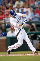 Texas Rangers third baseman Michael Young #10 swings during the Major League Baseball game against the Texas Rangers at the Rangers Ballpark in Arlington, Texas on July 27, 2011. Minnesota defeated Texas 7-2.  (Andrew Woolley/Four Seam Images)