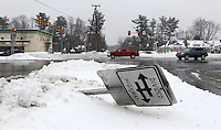 A road sign lays sideways at the intersection of Woodbrook Drive and US 29 Thursday after a snowfall in Charlottesville, VA. Photo/Andrew Shurtleff
