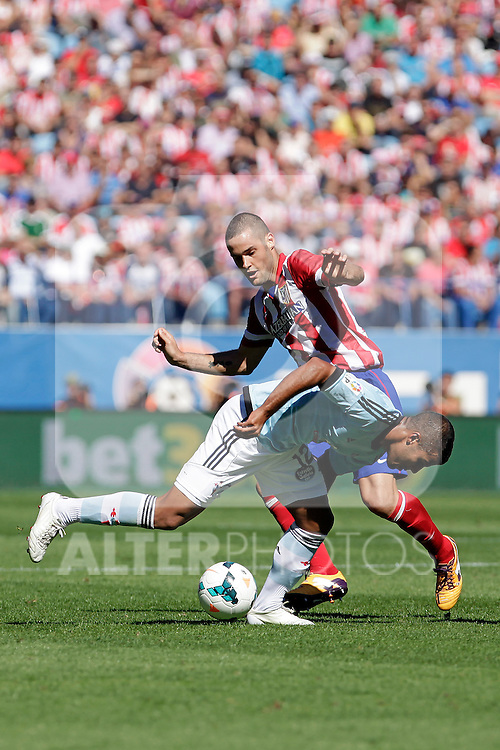 Atletico de Madrid´s Mario Suarez (B) and Celta de Vigo´s during La Liga 2013/14 match. October 06, 2013. (ALTERPHOTOS/Victor Blanco)