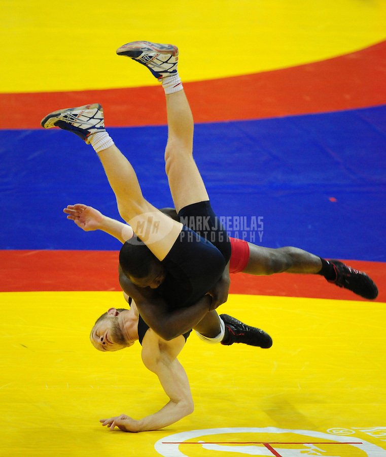 Jun 13, 2008; Las Vegas, NV, USA; Spenser Mango (red) body slams Sam Hazewinkel during the final in the greco roman 55kg class at the 2008 US Olympic Team Trials at the Thomas and Mack Center. Mango won and qualified for the Olympics. Mandatory Credit: Mark J. Rebilas-