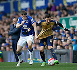 Seamus Coleman of Everton Mesut Ozil of Arsenal during the Barclays Premier League match at The Goodison Park Stadium. Photo credit should read: Simon Bellis/Sportimage