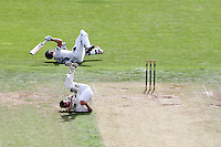 PICTURE BY ALEX WHITEHEAD/SWPIX.COM - Cricket - County Championship Div Two - Yorkshire v Glamorgan, Day 2 - Headingley, Leeds, England - 05/09/12 - Yorkshire's Andrew Gale (above) and John Glover (below) tumble over.
