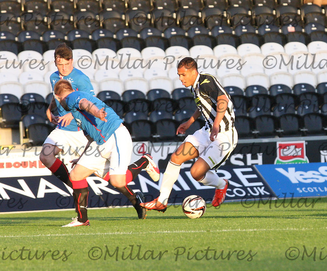 Jake Caprice turning Steven Smith in the St Mirren v Rangers Scottish Professional Football League Under 20 match played at St Mirren Park, Paisley on 10.9.13.