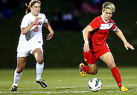 BOYDS, MARYLAND - April 06, 2013:  Lori Lindsey (6) of The Washington Spirit races away from Morgan Brian (6) of the University of Virginia women's soccer team in a NWSL (National Women's Soccer League) pre season exhibition game at Maryland Soccerplex in Boyds, Maryland on April 06. Virginia won 6-3.