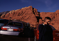"Ancient sand dunes are the backdrop for modern timjes.  Cell phones are everywhere, even in Nevada's Red Rock Canyon.  Mobile phones have come in handy summoning rescuers to climbers in distress or being within a ""cell yell"" of Las Vegas, a half hour's drive and a world away."