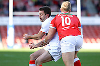 PICTURE BY ALEX WHITEHEAD/SWPIX.COM - Rugby League - Autumn International Series - Wales vs England - Glyndwr University Racecourse Stadium, Wrexham, Wales - 27/10/12 - England's Richard Myler is tackled by Wales' Craig Kopczak.