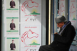SULAIMANIYAH, IRAQ:  An old man reading in the market is surrounded by election posters on the first day of official election campaigning...Election workers start their campaigns for the Iraqi Parliamentary Elections due to be held March 7th, 2010...Photo by Evan Adnan/Metrography