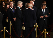 Memebers of the Supreme Court Brett Kavanaugh (L), Neil Gorsuch (C), and John Roberts (R) wait for the casket containing the remains of former US President George H.W. Bush to arrive at the US Capitol during a State Funeral in Washington, DC, December 3, 2018. - The body of the late former President George H.W. Bush will travel from Houston to Washington, where he will lie in state at the US Capitol through Wednesday morning. Bush, who died on November 30, will return to Houston for his funeral on Thursday. (Photo by Brendan SMIALOWSKI / AFP)