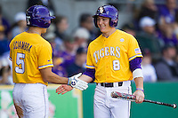 LSU Tigers first baseman Mason Katz #8 smiles as he is greeted by teammate Chris Sciambra #5 after scoring against the  Auburn Tigers in the NCAA baseball game on March 24, 2013 at Alex Box Stadium in Baton Rouge, Louisiana. LSU defeated Auburn 5-1. (Andrew Woolley/Four Seam Images).