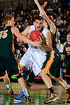 NOVEMBER 17, 2014 -- Andrew Rebol #55 of South Dakota Mines drives between Black Hills State defenders Collin Smith #15 and Riley Ryan #32 during their college men's basketball game Monday evening at the Donald E. Young Center in Spearfish, S.D.  (Photo by Dick Carlson/Inertia)