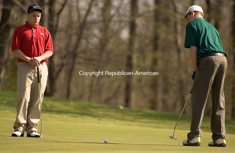WATERBURY, CT- 24 APRIL 2008 --042408JS13--Wolcott's Chris Catania, left, looks on as Holy Cross' Ian Walsh putts during their meet Thursday at Western Hills Golf Course in Waterbury. <br /> Jim Shannon / Republican-American