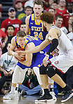 SIOUX FALLS, SD: MARCH 6: Reed Tellinghuisen #23 of South Dakota State shields the ball from Trey Burch-Manning #12 of South Dakota during the Summit League Basketball Championship on March 6, 2017 at the Denny Sanford Premier Center in Sioux Falls, SD. (Photo by Dick Carlson/Inertia)