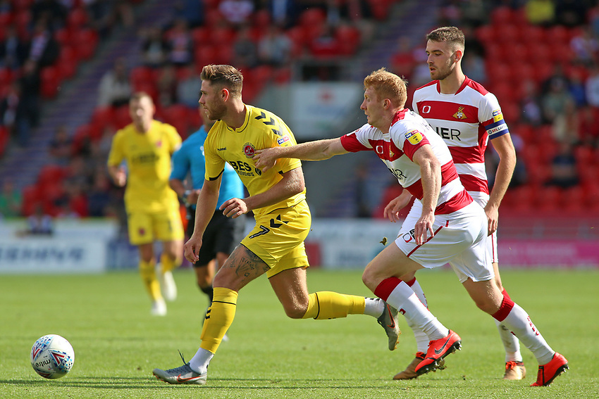 Fleetwood Town's Wes Burns gets away from Doncaster Rovers' Brad Halliday<br /> <br /> Photographer David Shipman/CameraSport<br /> <br /> The EFL Sky Bet League One - Doncaster Rovers v Fleetwood Town - Saturday 17th August 2019  - Keepmoat Stadium - Doncaster<br /> <br /> World Copyright © 2019 CameraSport. All rights reserved. 43 Linden Ave. Countesthorpe. Leicester. England. LE8 5PG - Tel: +44 (0) 116 277 4147 - admin@camerasport.com - www.camerasport.com