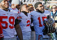 Ohio State Buckeyes running back Ezekiel Elliott (15) holds the Illibuck following their win over Illinois at Memorial Stadium in Champaign, Ill on November 14, 2015. (Columbus Dispatch photo by Brooke LaValley)